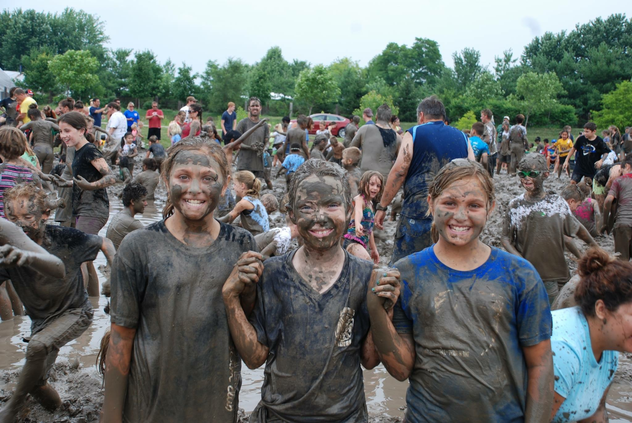 Youths covered in mud