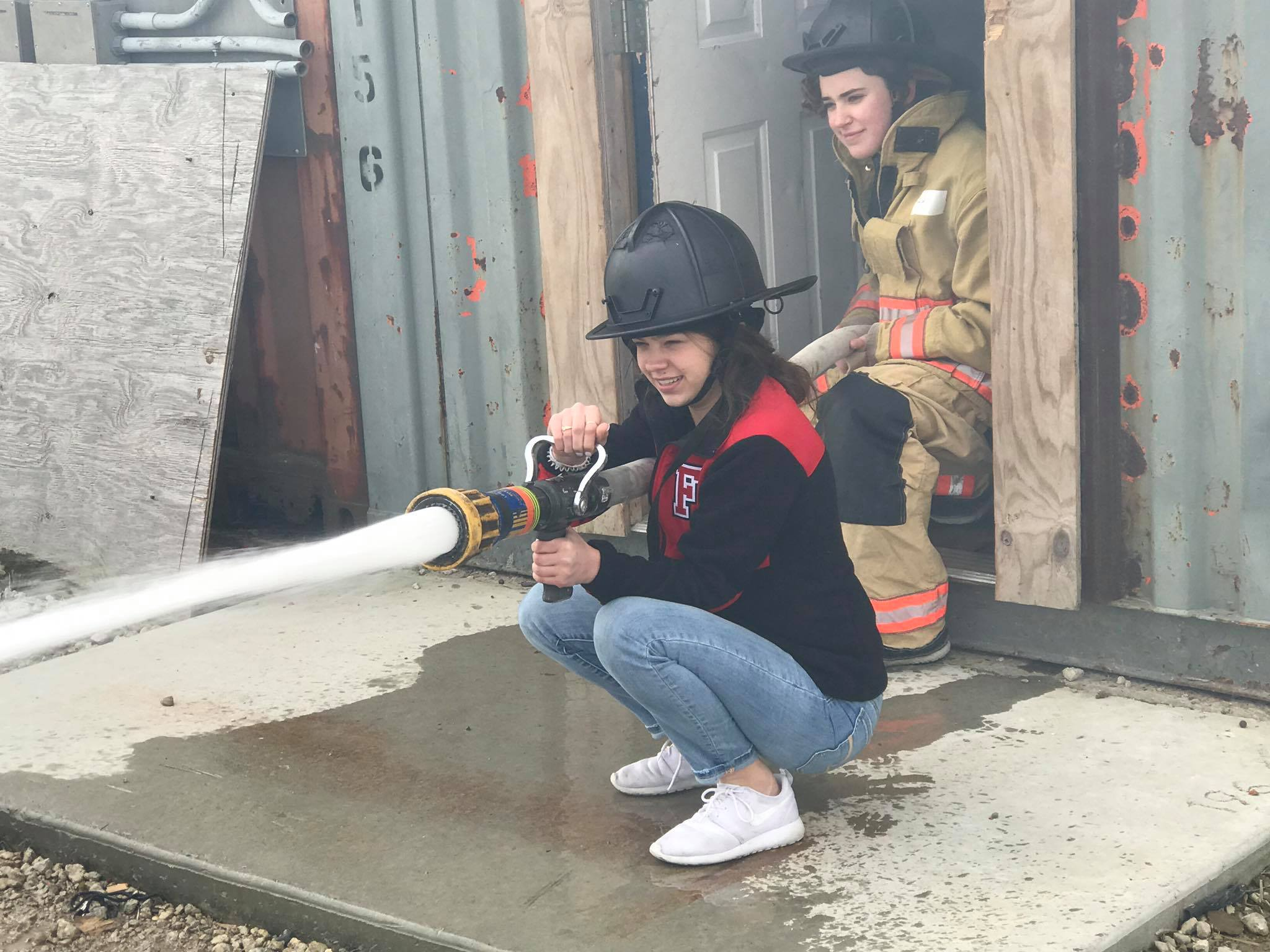 girl with fire hose