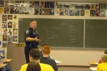 Police Officer Teaching about DARE